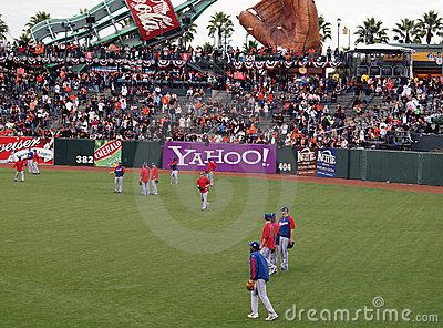 Players taking balls in the outfield Editorial Image