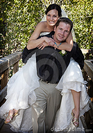 Playful Bride and Groom piggyback
