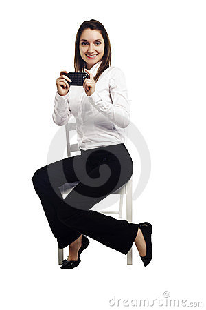 Playful business woman taking picture on phone