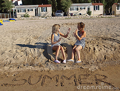 Playful children at sand beach