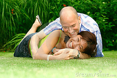 Playful couple in garden
