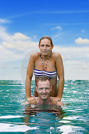 Playful couple in the water