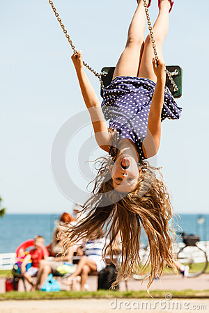 Free Playful Crazy Girl On Swing. Royalty Free Stock Photography - 84611697