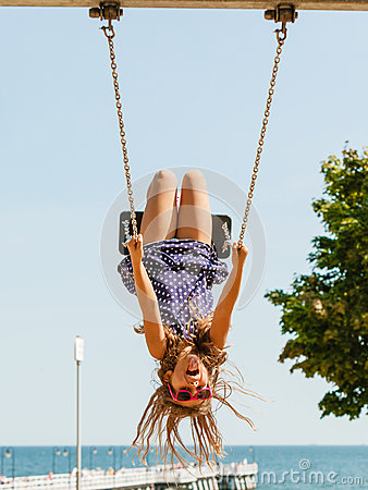 Free Playful Crazy Girl On Swing. Stock Photography - 88838252