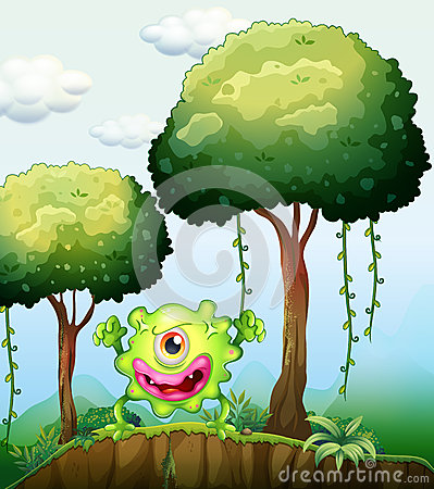 A playful green monster at the cliff in the forest