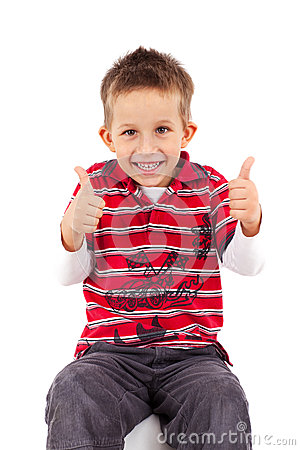 Playful little boy thumbs up