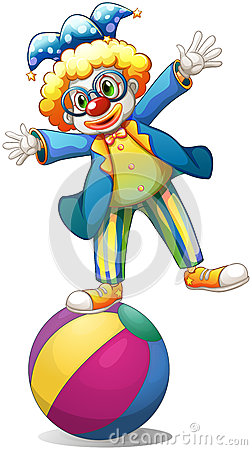 A playful male clown at the top of a ball