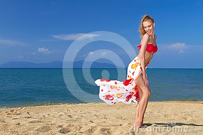Playful moment with a pretty blonde on the beach