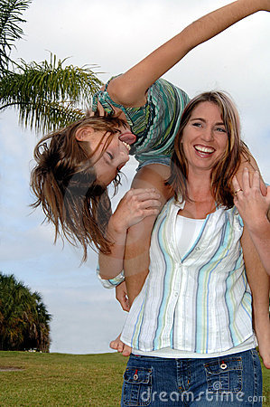 Playful mother and daughter