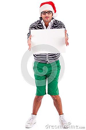 Playful santa boy with a blank board