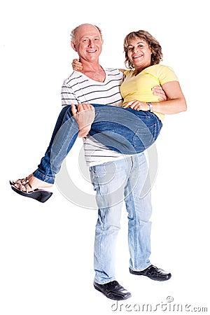 Playful senior couple having fun indoors