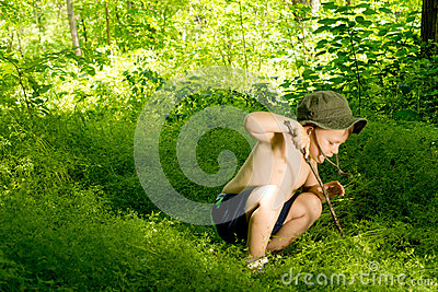Playful small boy discovering nature