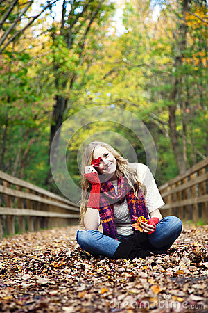Playful woman in autumn
