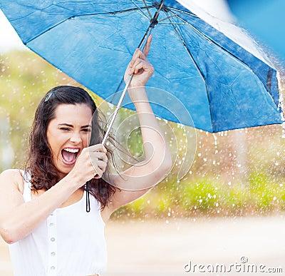 Playful woman in rain