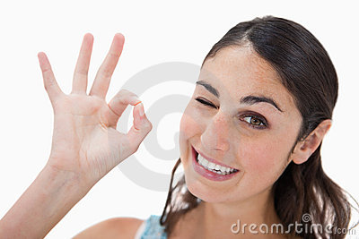 Playful woman signing that everything is fine