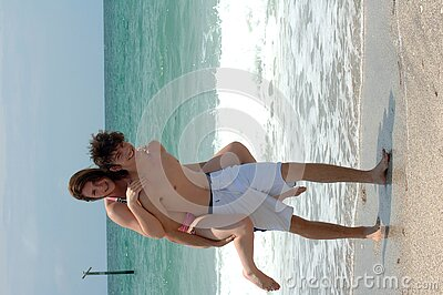 Playful young beach couple