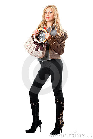 Playful young blonde with a handbag. Isolated
