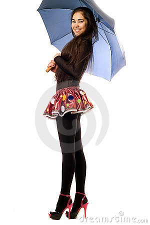 Playful young woman with umbrella