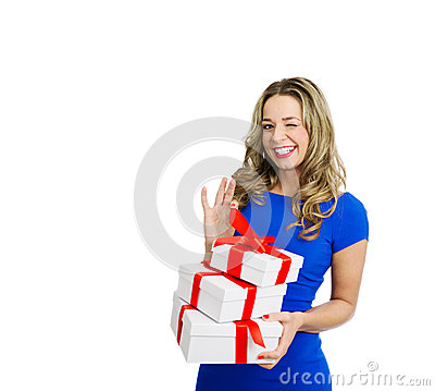 Playfull Beautiful woman with stack of gift boxes