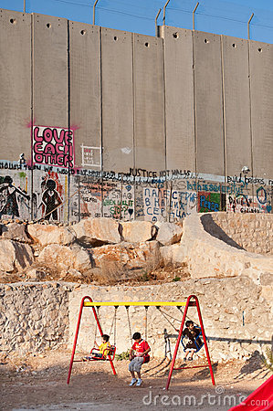 Playground and Israeli Separation Wall Editorial Image