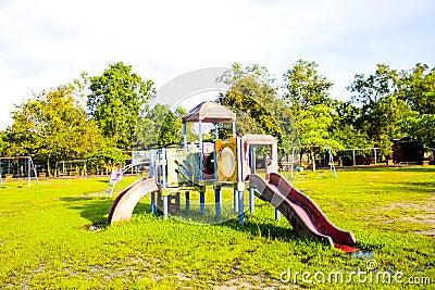 Playground park on grass near school is children