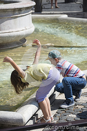Free Playing At The Fountain Royalty Free Stock Photo - 44745315
