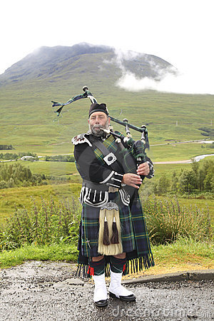 Playing bagpiper Editorial Stock Image
