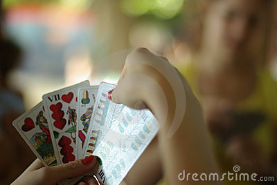Playing a card game in shallow depth of field