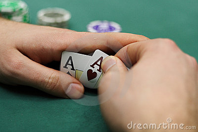 Playing cards and chips in hands