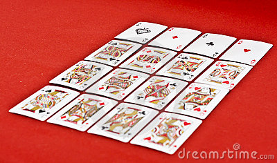 Playing Cards  on Red Fabric