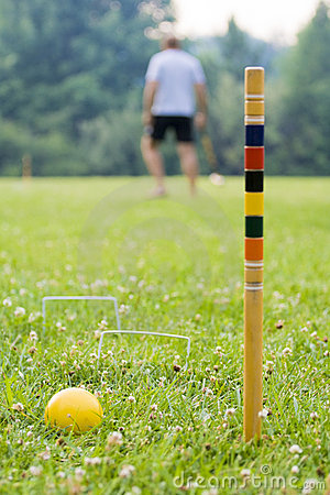 Playing croquet