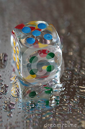 Free Playing Dice In Transparent Resin And Multicolored Numbers Royalty Free Stock Photos - 56490048