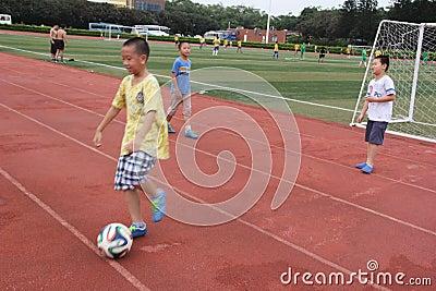 The playing football of boys in shenzhen shekou sports center