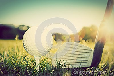 Playing golf, ball on tee and golf club