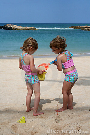 Free Playing In The Beach Stock Photo - 5076770