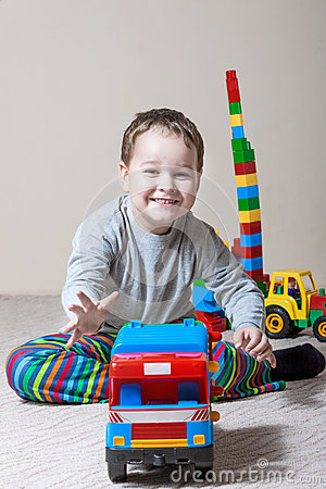 Free Playing Little Boy With Colored Cubes Royalty Free Stock Photo - 74070975