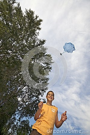 Playing with parachute toy vertical