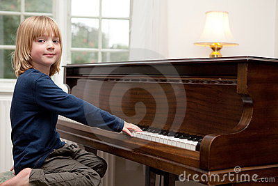 Playing piano music, boy Child instrument