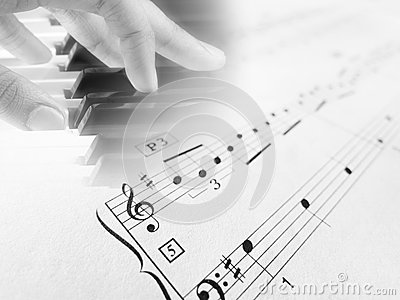 Playing piano sheet music notes