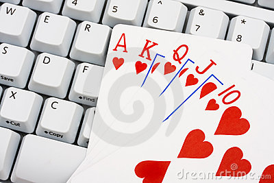 straight flush sitting on a computer keyboard, Playing poker online