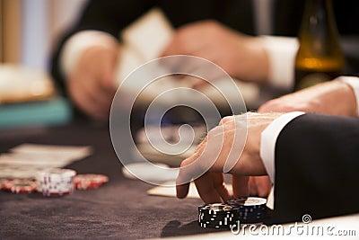 Playing poker at table gamblin