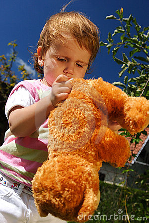 Playing with the teddy bear