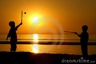 Playing Tennis On The Beach