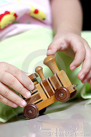 Free Playing With A Wooden Train Toy Stock Photography - 16753922