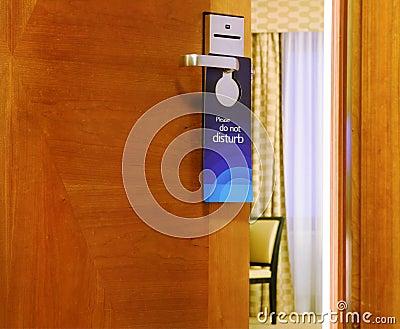 Please do not disturb sign hanging on open door