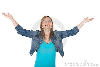 Pleased girl with arms open