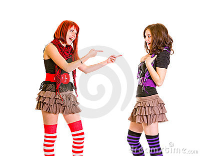 Pleased girl pointing fingers at her girlfriend