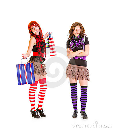 Pleased girl showing bags to her sad girlfriend