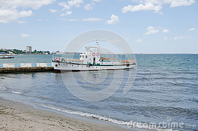 Pleasure boat on a mooring in Feodosia Editorial Photo