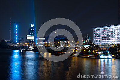 Pleasure boats in the night illumination on the River Spree Editorial Photo